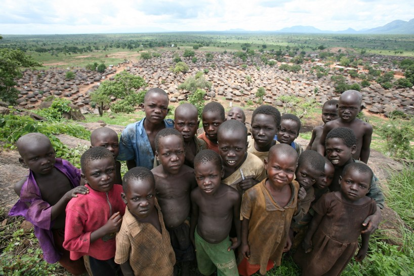 Children pose for a photo on a hill overlooking Omiya- Anyima IDP camp in Kitgum District, northern Uganda. Photo: Manoocher Deghati/IRIN