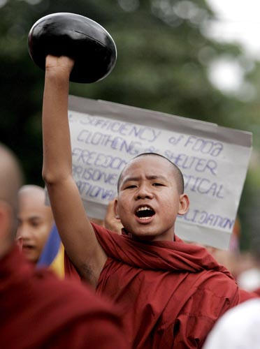 "Myanmar Buddhist monks gather in the streets in the vicinity of Shwedagon pagoda in Yangon, Myanmar, on 24 September 2007, the seventh day of peaceful rebellion against the country's military regime.  Photo by ""Racoles."""