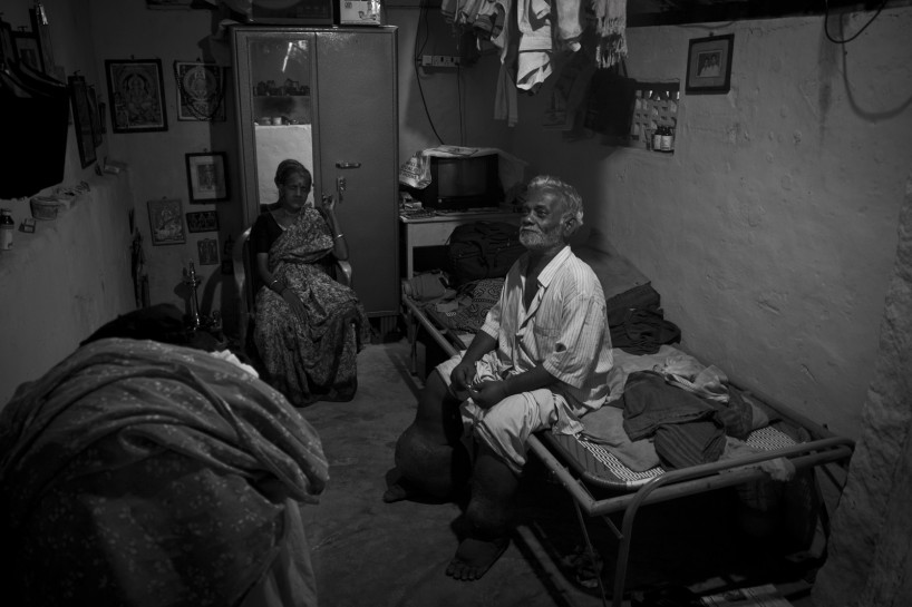 """""""Velayuthan pillai (Age 69), a tailor. Elephantiasis turned his life into misery by taking away both his legs. Having lost his legs and job, he returned back to his home town and joined as a guard for a temple for the pay of (Rupess 800) 17.60$ per month. With the help of this little income he's struggling to make both ends in life along with his wife."""" Photo by Rajvinoth Jothineelakandan."""