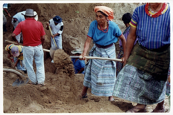Community members exhume the bodies of people killed in the violent massacres of the 1980's and 90's.  Photo: Bert Hanson.