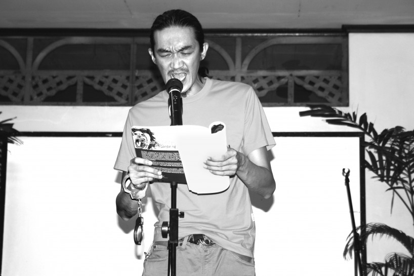 Axel Pinpin, poet, activist and agriculturist, reading from Tungmaang Matatabil, a collection of poems written over the 2-year period he was imprisoned.